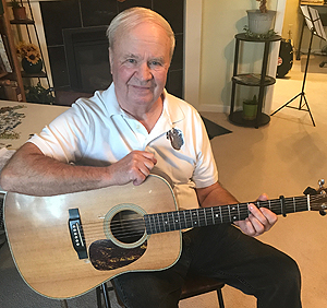 Walt Crider at home with his guitar